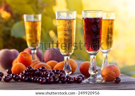 Sweet wine and fruits on  wooden table - stock photo
