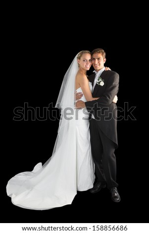 Sweet young couple posing embracing each other on black background - stock photo