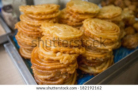 sweet zlabia piled in a plate - stock photo