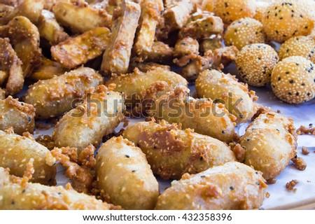 sweetened fried banana and potato. - stock photo