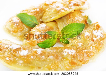 Sweetened fried banana on plate, close-up - stock photo