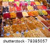 Sweets and dried fruits in the market - stock photo