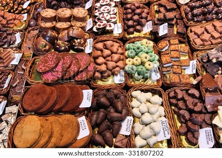 Sweets store at Boqueria market place in Barcelona, Spain. Assorted chocolate candy shop. - stock photo