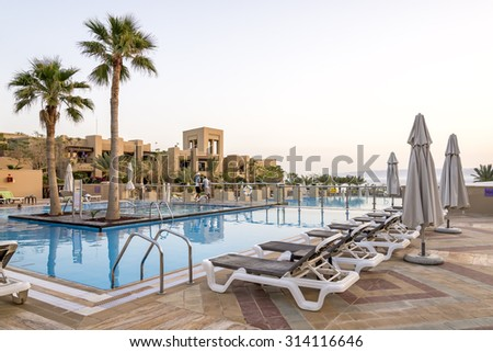 Sweimeh, Jordan - April 07, 2015: View of Holiday Inn Resort Dead Sea swimming pool. Nestled on the beach, this resort is within 25 mi of Mount Nebo, St George Church, and Madaba Archaeological Park. - stock photo