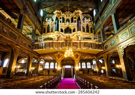 SWIDNICA, POLAND - MARCH 21, 2015: Interior of UNESCO listed 17th century Church of Peace in Swidnica town, Poland. It is one of the biggest timber-framed religious buildings in Europe. - stock photo