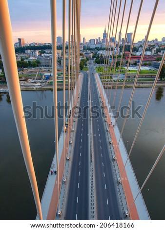 Swietokrzyski Bridge over Wisla river in Warsaw capital of Poland - stock photo