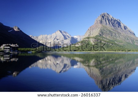 Swiftcurrent Lake, mountains, and reflection in Glacier National Park, Montana - stock photo