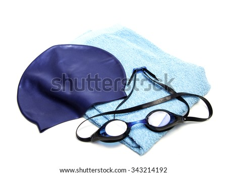 Swim equipment: swim cap, towel & goggles - stock photo