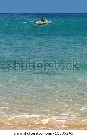 swimmer in a bay of St. Barth, Caribbean