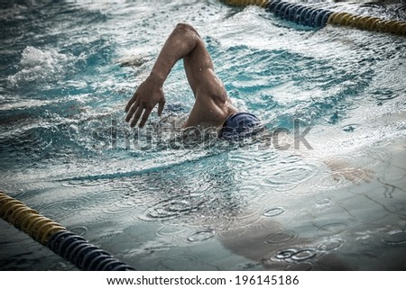 Swimmer in a swimming pool using crawl technique  - stock photo