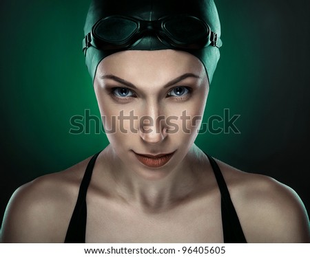 swimmer in dark green light