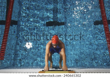 Swimmer Preparing to Dive in Pool - stock photo