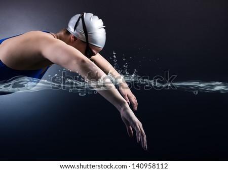 Swimmer swims. - stock photo