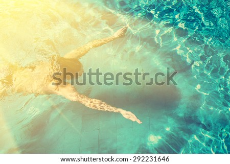 Swimmer with shadow and halo - stock photo