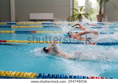 swimming competition in pool