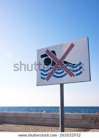 swimming forbidden, no swimming sign at the port - stock photo