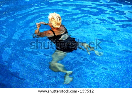 swimming in a swimming pool - stock photo