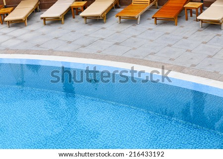 Swimming pool and bed - stock photo