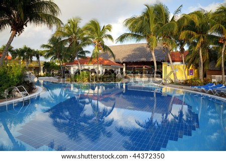 swimming pool and hotel resort - stock photo