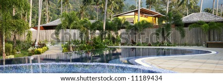Swimming pool and jacuzzi in the health resort surrounded by exotic vegetation. Leisure and relaxation concept. 2H panorama. - stock photo