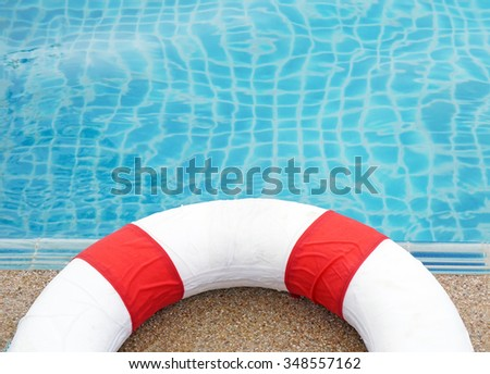 Swimming pool and lifeguard, Ring Pool. - stock photo