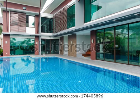 Swimming pool and modern building  - stock photo