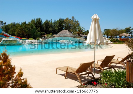 Swimming pool and sunbeds by a beach at the luxury hotel, Halkidiki, Greece
