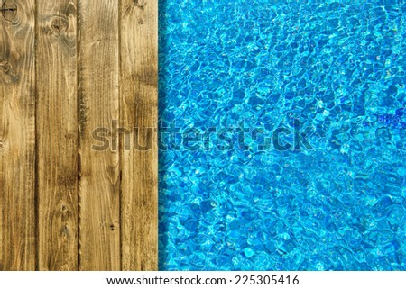 Swimming pool and wooden deck for backgrounds - stock photo