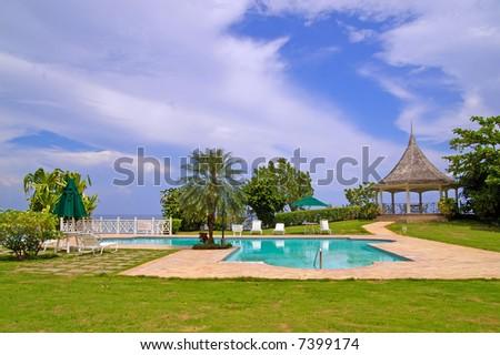 swimming pool at beachfront property - stock photo