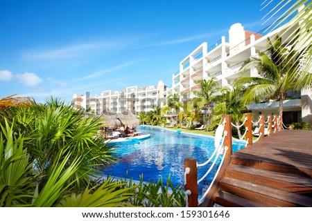 Swimming pool at caribbean resort. Exotic garden. - stock photo
