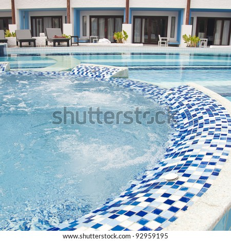 Swimming pool at hotel - stock photo