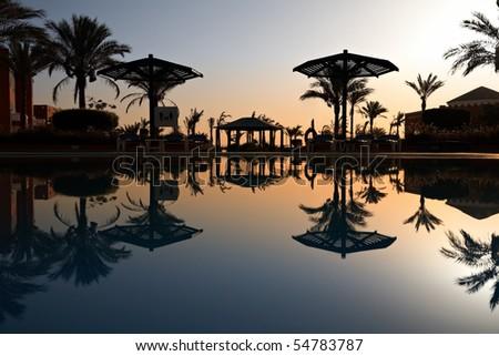 swimming pool at morning, Hurghada, Egypt - stock photo