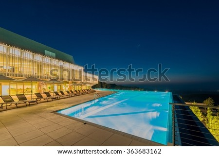 Swimming pool at night time - stock photo
