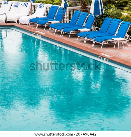 Swimming pool at rainy day - stock photo