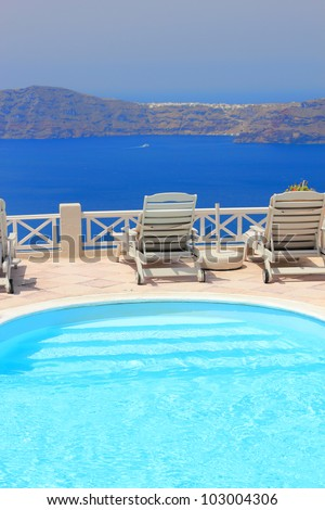 Swimming pool at Santorini island Greece - stock photo