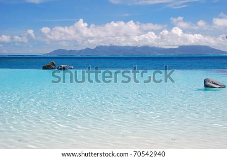 swimming pool at tahiti and view of moorea island - stock photo