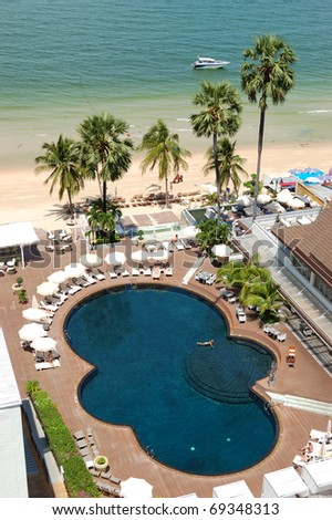 Swimming pool at the beach of popular hotel, Pattaya, Thailand - stock photo