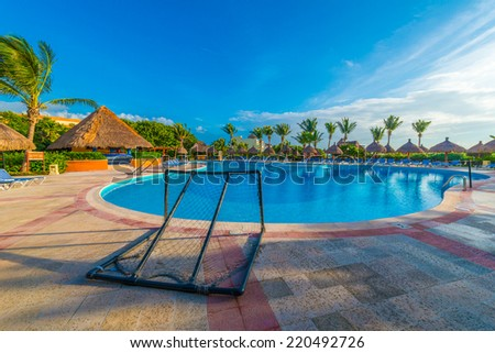 Swimming pool at the luxury mexican resort at early morning hours.