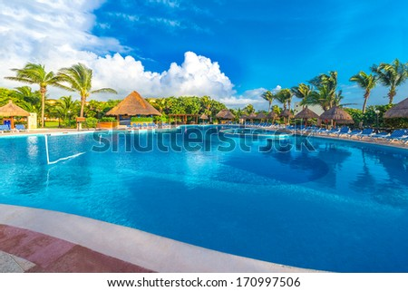 Swimming pool at the luxury mexican resort at early morning hours, time. Bahia Principe, Riviera Maya.