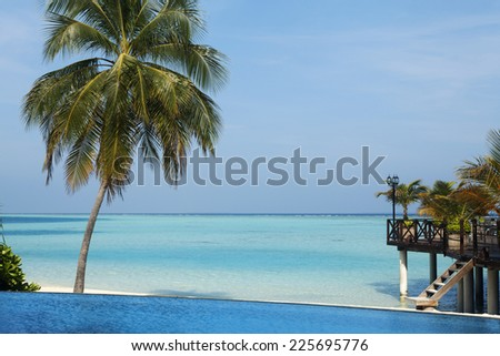 Swimming pool at the luxury resort at early morning hours - stock photo