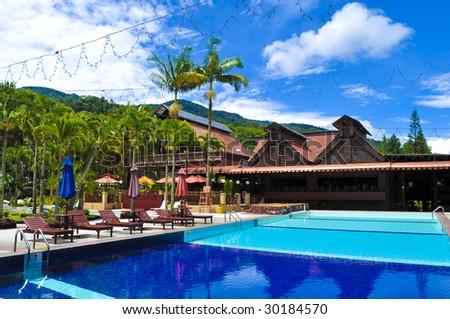 Swimming Pool at Tropical Resort - stock photo