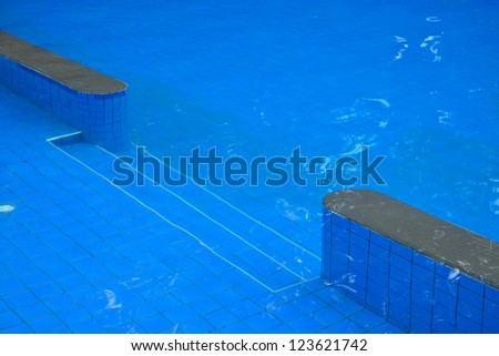 swimming pool blue water and wood flooring