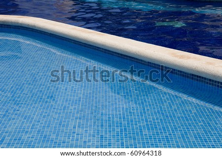 swimming pool blue water detail in summer time - stock photo
