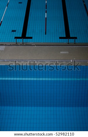 swimming pool from diving board - stock photo
