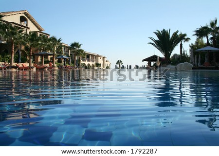 swimming pool from the surface of the water - stock photo