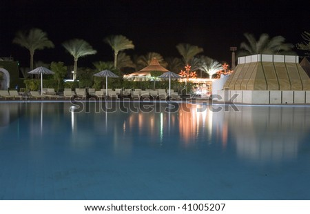 Swimming pool in a hotel at night - stock photo