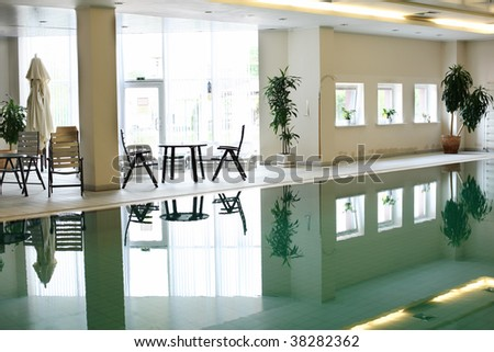Swimming pool in a hotel in front of bright window - stock photo