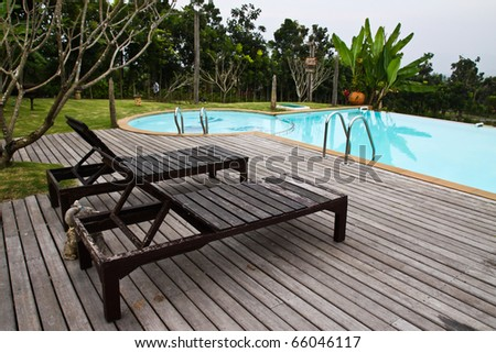 swimming pool in a resort - stock photo