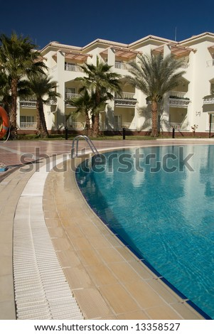 Swimming pool in a tropical resort hotel