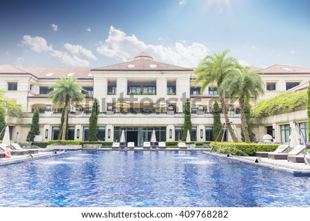 swimming pool in back yard of holiday hotel in hangzhou - stock photo